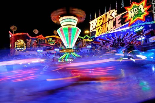 Breakdance ride at night, carousel, motion blur, Cannstatter Wasen or Volksfest, Stuttgart Beer Festival, Wasen, Bad Cannstatt, Stuttgart, Baden_Wuerttemberg, Germany, Europe : Stock Photo