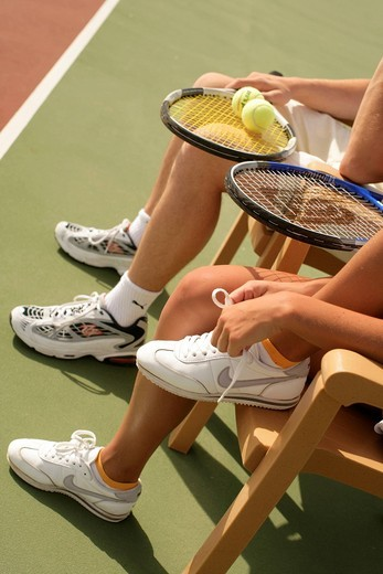 Young couple, tennis, detail of the legs : Stock Photo