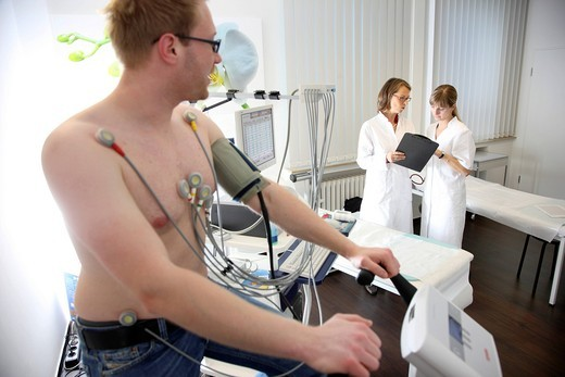 Medical practice, stress ECG, test to measure the cardiac function of a patient on a cardio machine : Stock Photo