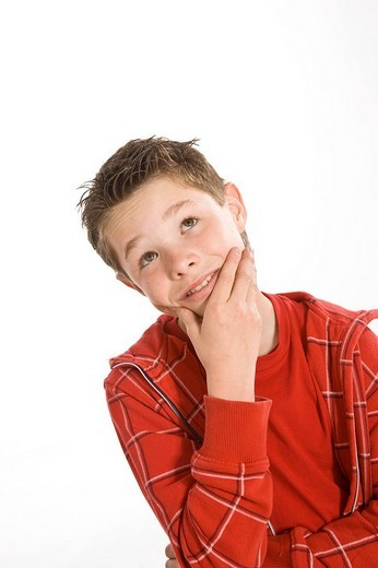 Portrait of a pensive boy : Stock Photo