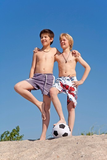 Two boys with a football on the beach, Timmendorf, Poel island, Mecklenburg_Western Pomerania, Northern Germany : Stock Photo
