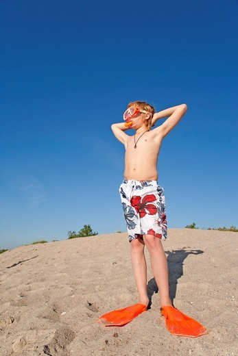 Stock Photo: 1848-491023 Portrait of a young boy with flippers, snorkel and diving goggles on the beach, Timmendorf, Poel island, Mecklenburg_Western Pomerania, Northern Germany