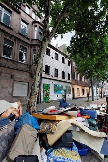 Bulk waste on the roadside, Kaiser_Wilhelm_Strasse, Bruckhausen district, Duisburg, North Rhine_Westphalia, Germany, Europe : Stock Photo