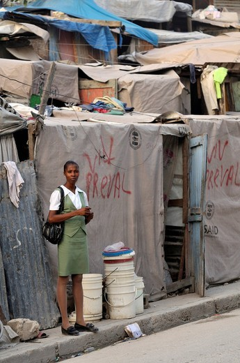 Young woman going to work, slums of Fort National, the district was largely destroyed by the earthquake in January 2010, Port_au_Prince, Haiti, Caribbean, Central America : Stock Photo