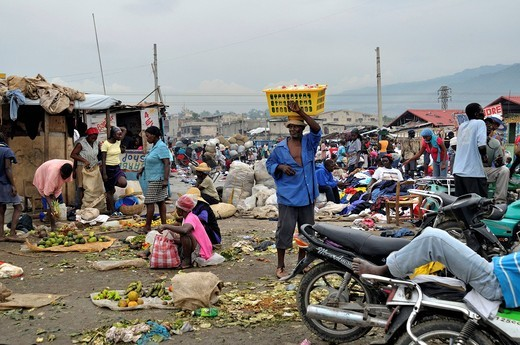 Stock Photo: 1848-491475 Vendor of food and used clothing in the urban market of Des Croix Bossales in the port district of La Saline, Port_au_Prince, Haiti, Caribbean, Central America