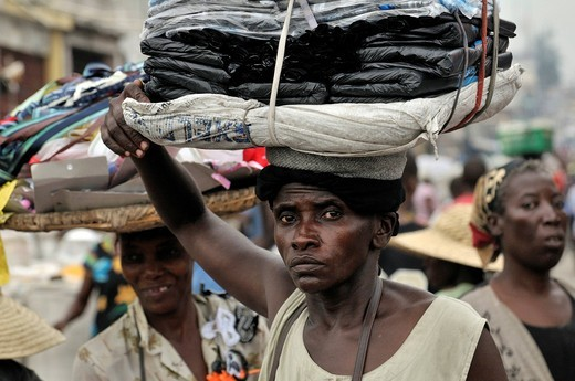 Stock Photo: 1848-491476 Female vendor carrying the goods on her head, urban market of Des Croix Bossales in the port district of La Saline, Port_au_Prince, Haiti, Caribbean, Central America