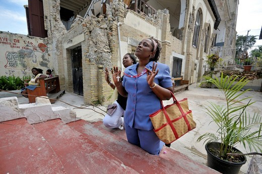 Stock Photo: 1848-491583 Young women climbing the Holy Stairs on their knees for atonement, next to the church Sacre Coeur destroyed in the earthquake in January 2010, Turgeau district, Port_au_Prince, Haiti, Caribbean, Central America
