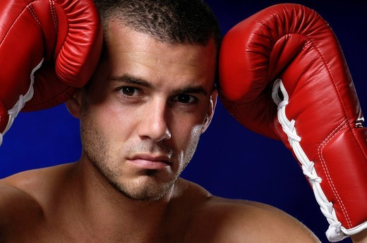 Man, 30 years, portrait, boxing gloves : Stock Photo