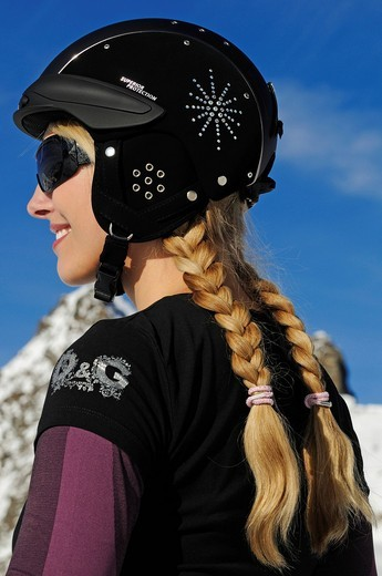 Young woman wearing a ski helmet, Hochstubai, Tyrol, Austria, Europe : Stock Photo