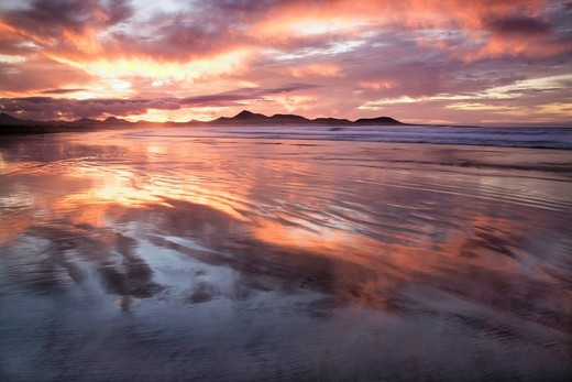 Stock Photo: 1848-493329 Sunset reflecting over Famara Beach, Lanzarote, Canary Islands, Spain, Europe