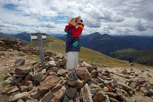 Stock Photo: 1848-493383 Boy looking through binoculars, Nockberge National Park, Carinthia, Austria, Europe