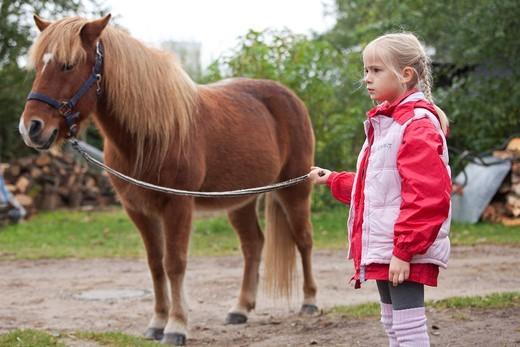Stock Photo: 1848-493903 Young girl with a pony