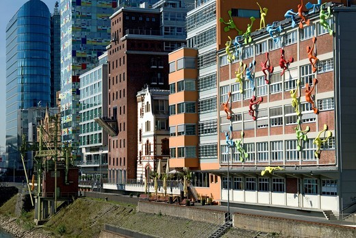 Varied colourful architecture with the Flossies installation by Rosalie in the foreground, Medienhafen media harbour, Duesseldorf, North Rhine_Westphalia, Germany, Europe : Stock Photo