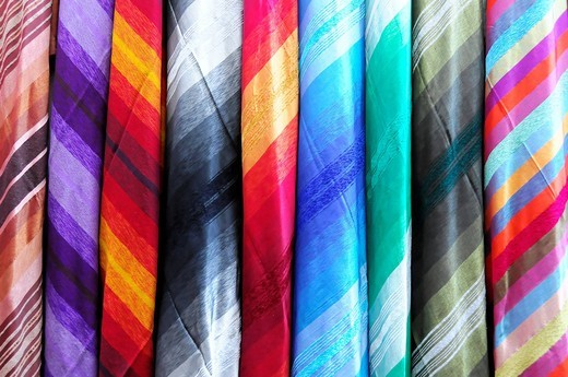 Coloured cotton cloth, souk market in Fez, Morocco, Africa : Stock Photo