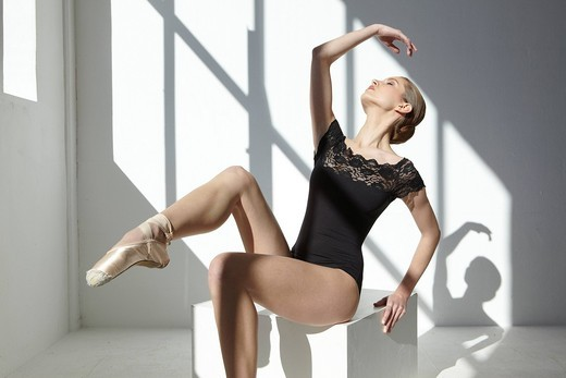Stock Photo: 1848-495083 Ballet dancer wearing a black leotard in a white room