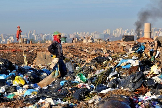 Young man searching for recyclables at the Lixao dump in the satellite city of Estrutural near Brasilia, Distrito Federal, Brazil, South America : Stock Photo