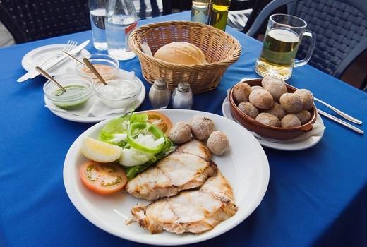 Stock Photo: 1848-496332 Grilled fish with Canarian potatoes, Papas Arrugadas, Souce Mojo Rojo, Mojo Verde, Spanish food, Puerto del Carmen, Lanzarote, Canary Islands, Spain, Europe