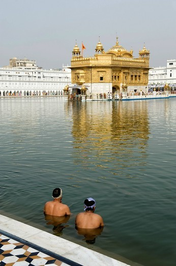 Stock Photo: 1848-496710 Sikhism, ritual washing, two believers of the Sikh taking a ritual bath in the lake, sacred Golden Temple, Hari Mandir, Amritsar, Punjab, India, South Asia