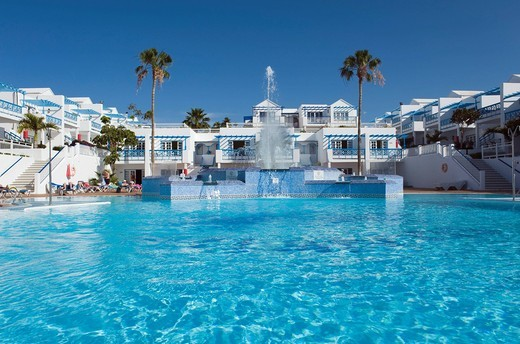 Swimming pool in a hotel, Atlantis Las Lomas Apartments, Puerto del Carmen, Lanzarote, Canary Islands, Spain, Europe : Stock Photo