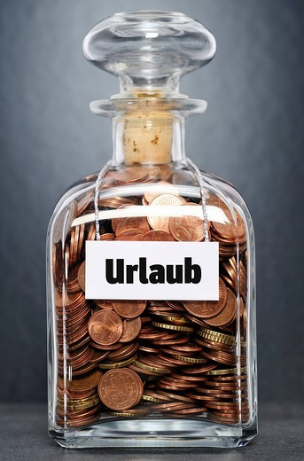 Stock Photo: 1848-497761 Glass jar filled with euro cent coins, labelled Urlaub, German for vacation