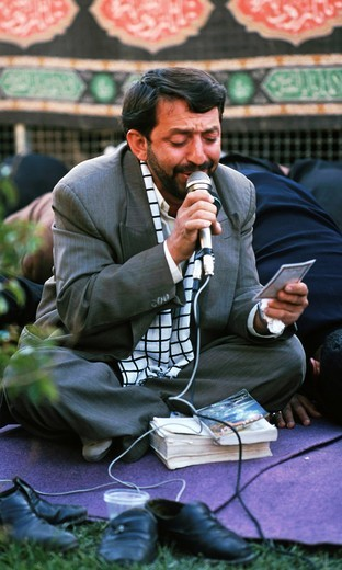 Prayer leader, Ashura rituals, penitent processions, Isfahan, Iran : Stock Photo
