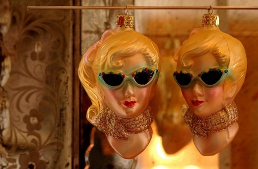 Retro ornaments from the 1950s featuring two blonde women wearing sunglasses and scarves : Stock Photo