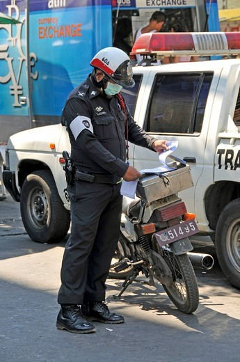 Police office wearing surgical mask, Bangkok, Thailand, Southeast Asia, Asia : Stock Photo