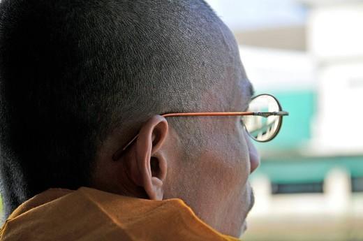 Stock Photo: 1848-501591 Monk wearing glasses, Bangkok, Thailand, Southeast Asia