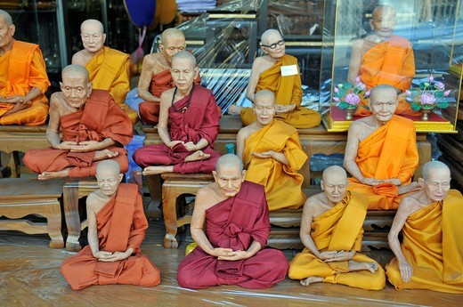 Monk figurines and other devotional objects for sale along Bamrung Muang Road, Bangkok, Thailand, Southeast Asia : Stock Photo