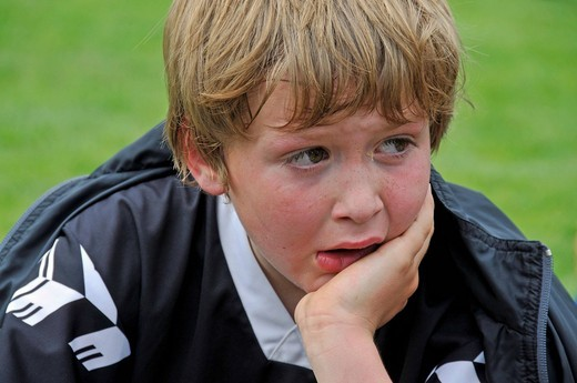 An eight_year_old player of the F_2 Junior League, very disappointed and close to tears after a defeat, Children´s Football Tournament, Blaustein, Baden_Wuerttemberg, Germany, Europe : Stock Photo