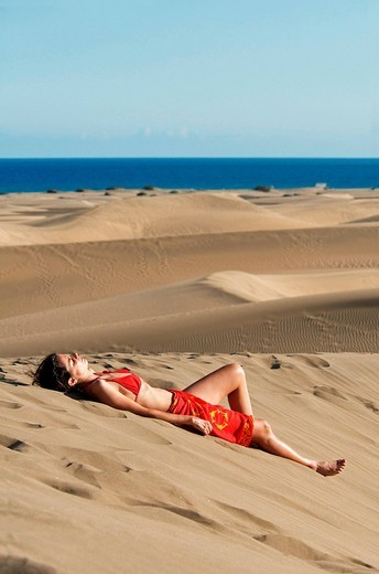 Woman in the sand dunes of Maspalomas, Gran Canaria, Canary Islands, Spain, Europe : Stock Photo