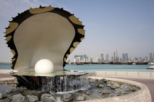 Pearl Monument, Corniche, Doha Bay, newly constructed buildings, high rise district on the north bank of the Corniche, Doha, Qatar : Stock Photo