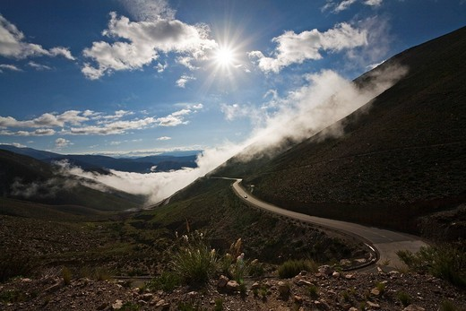 Pass road across the Andes through the clouds and fog, direction Jama pass Paso de Jama, Argentina, South America : Stock Photo