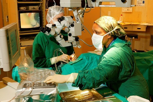 Physician looking through a microscope during cataract surgery in Pietermaritzburg, South Africa, Africa : Stock Photo