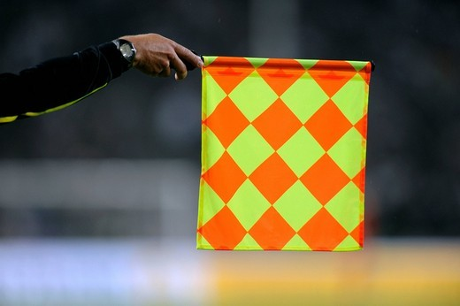 Flag of the assistant referee indicating offside, qualifier for the UEFA European Football Championship 2012, Germany _ Azerbaijan 6:1, RheinEnergieStadion stadium, Cologne, North Rhine_Westphalia, Germany, Europe : Stock Photo