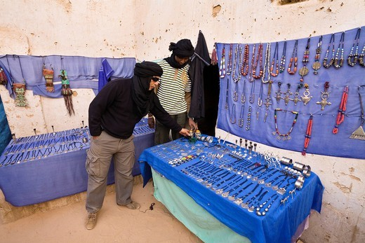 Tuareg in a souvenir shop in the historic centre of Ghat, Libya, Africa : Stock Photo