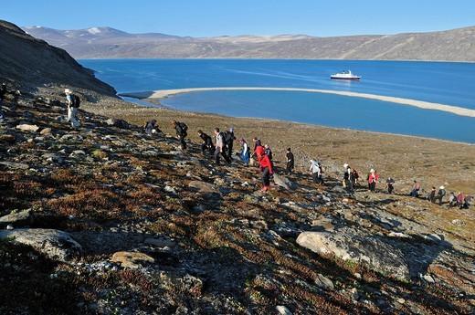Stock Photo: 1848-532090 Cruiseship passengers hiking on a rocky slope of Sunshine Fjord, Baffin Island, Nunavut, Canada, Arctic