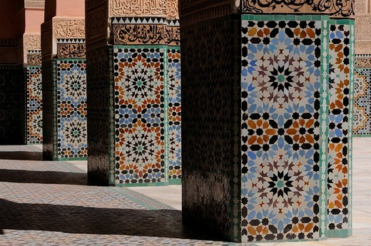 Ornate columns with mosaics, Ali ben Youssef Medersa building, Marrakech, Morocco, Africa : Stock Photo