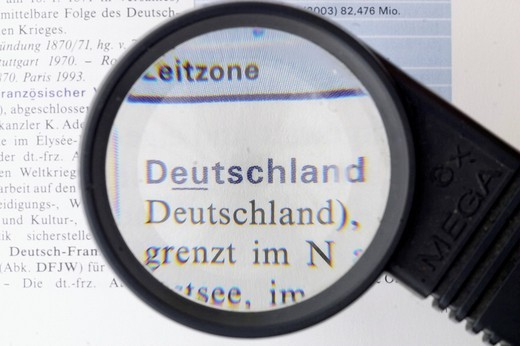 Germany, german word, magnifying glass : Stock Photo