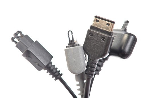 Various plugs for mobile phone charging connections, micro_USB plug standardization in 2011 : Stock Photo