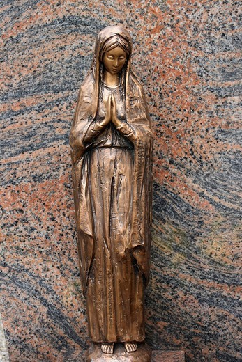 Statue of Mary on a tombstone : Stock Photo