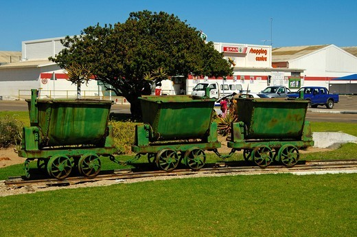 Stock Photo: 1848-53397 Old mine carts in front of the Spar Supermarket in the access_restricted De Beers diamond town Kleinzee, Northern Cape, South Africa