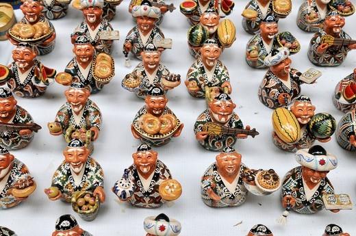 Stock Photo: 1848-534478 Pottery, souvenirs, crowd of smiling Uzbek men, figurines, Bukhara, Buchara, Silk Road, Uzbekistan, Central Asia