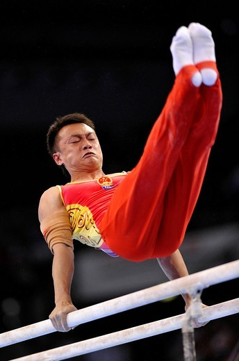 Guanyin Wang, CHN, on the parallel bars, EnBW Gymnastics World Cup 2010, 28th DTB_Cup, Stuttgart, Baden_Wuerttemberg, Germany, Europe : Stock Photo