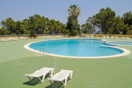 Stock Photo: 1848-536130 Deckchairs, empty swimming pool, holiday resort, residential complex, Punta Grossa, Cala de San Vicente bay, Ibiza island, Pityuses, Balearic Islands, Spain, Europe
