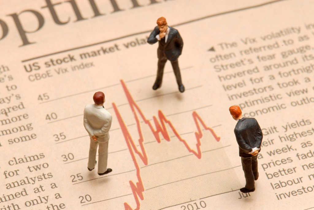 Stock Photo: 1848-536566 Miniature businessmen figures standing on a stock market chart