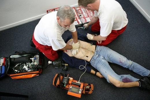 DEU Germany : Rescue paramedics in a private home attempt at resuscitation after a cardiac arrest. Training situation. , : Stock Photo