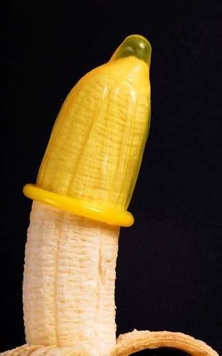 Stock Photo: 1848-537340 Banana with condom, symbolic image for contraception