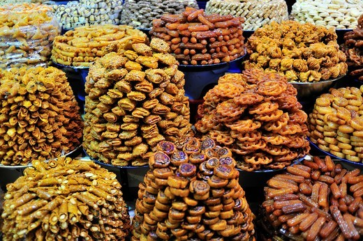 Sweets baked in oil being sold in the souk, bazaar, for Ramadan, Meknes, Morocco, Africa : Stock Photo