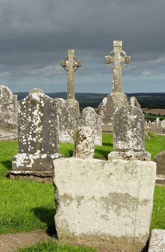 Stock Photo: 1848-53848 Old weahtered tombstoned at the cemetery of Slane Hill illuminated by sun beam